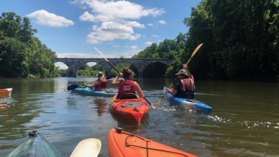 Photo of three kayakers on the Schuylkill River.